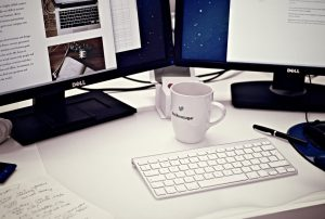 Computer workstation with keyboard and coffee cup