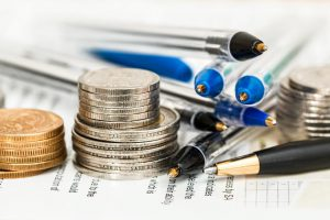 Picture of coins, pens and financial printout