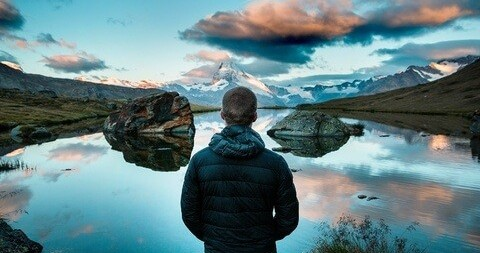 Dream Big - A hiker looking out over a mountain lake