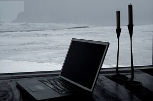 Laptop sitting at the beach